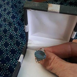 Light blue saphire 14 it gold ring with diamond